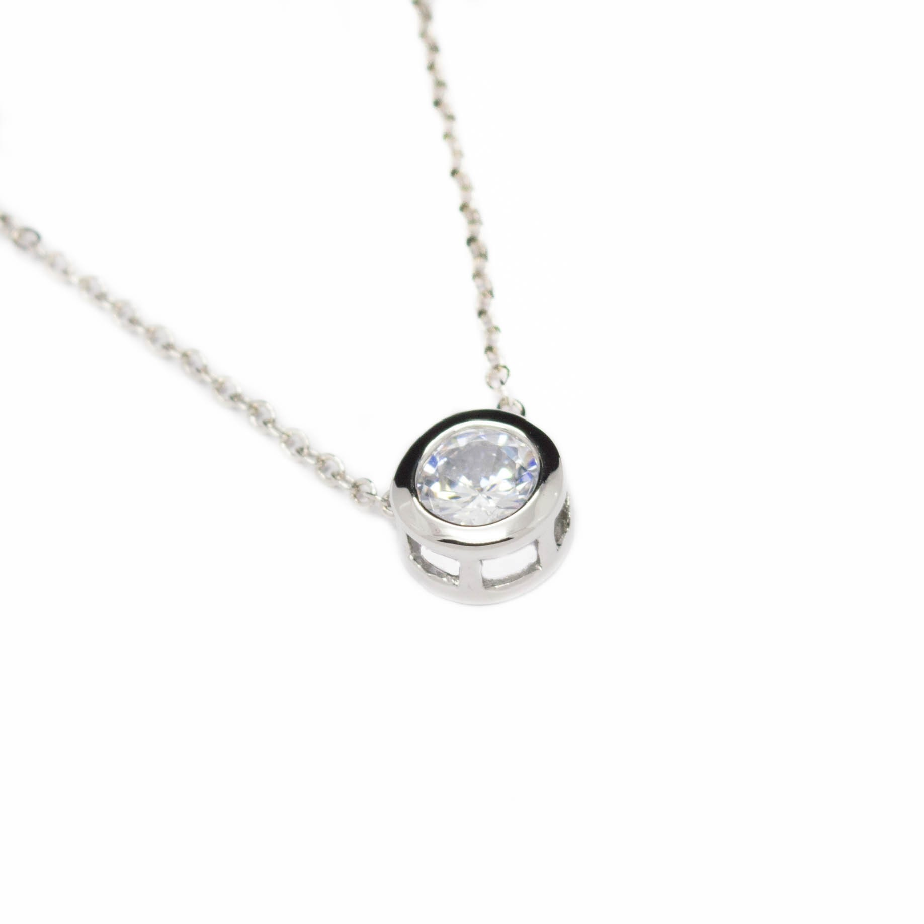 Women s white gold necklace with a round strass pendant
