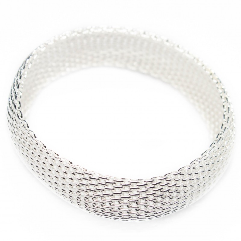 Women's wide silver bangle bracelet with a mesh texture