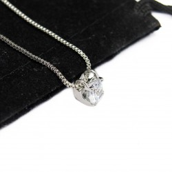 Women's white gold necklace with claw shaped pendant